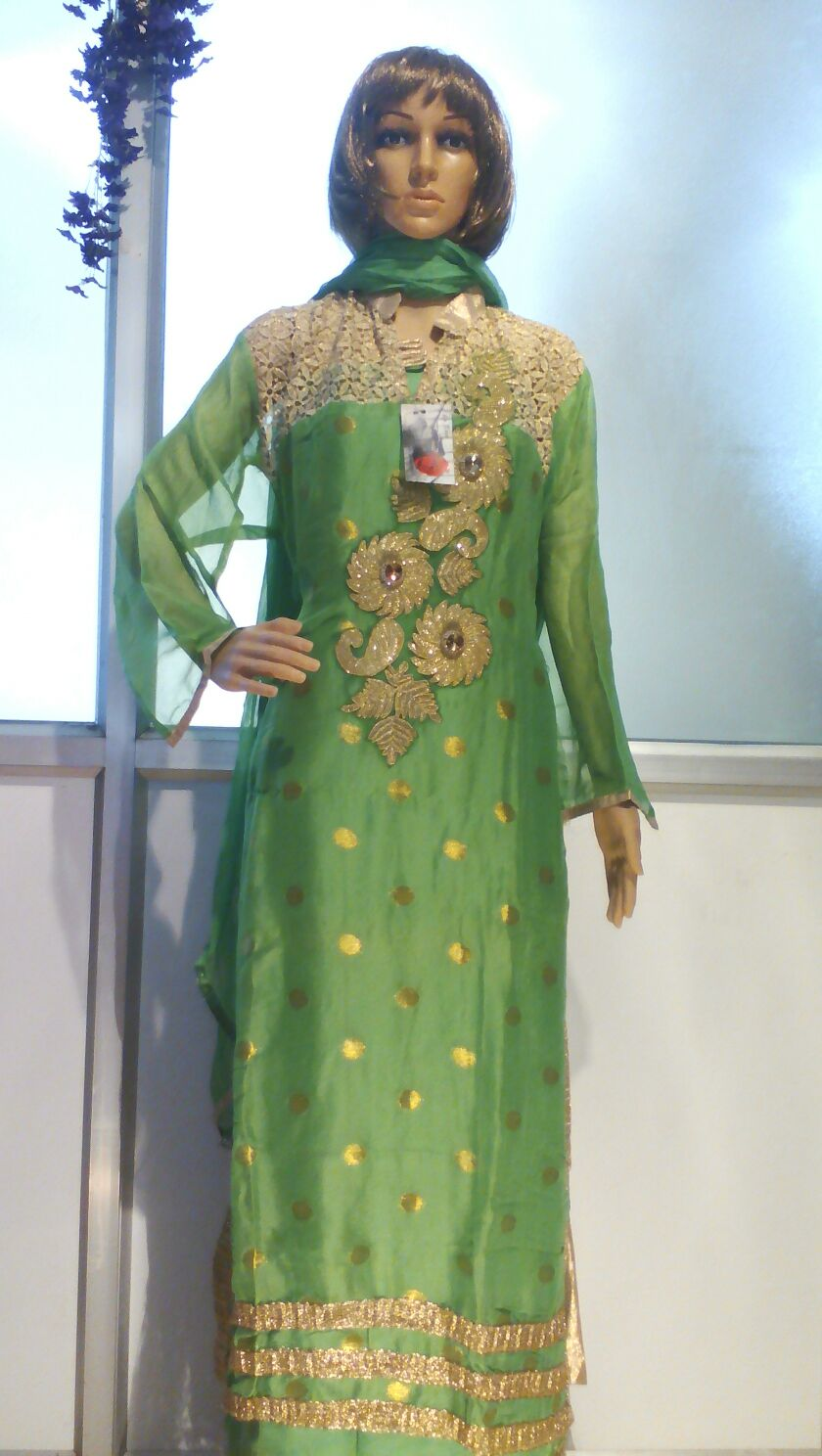 green semi stitched net georgette suit